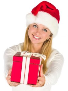 woman-giving-chirstmas-gift-with-santa-hat-not sure if I should be giving you gifts, but I am anyway