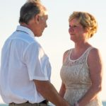 a photo of older couple holding hands wedding marriage family issues